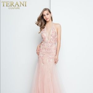 Intricately beaded blush-nudes halter gown